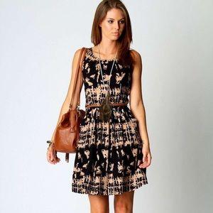Printed sleeveless belted dress